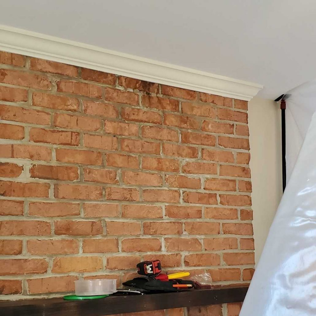 Brick wall in a home showing a water leak